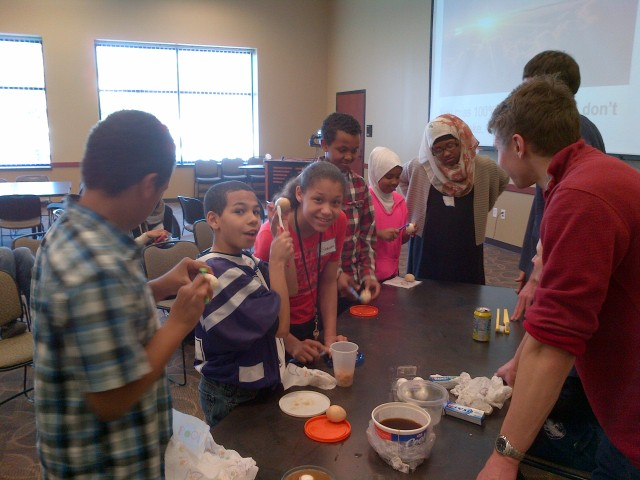 "Medical scholars brushing stained ""teeth"" (eggs!)"